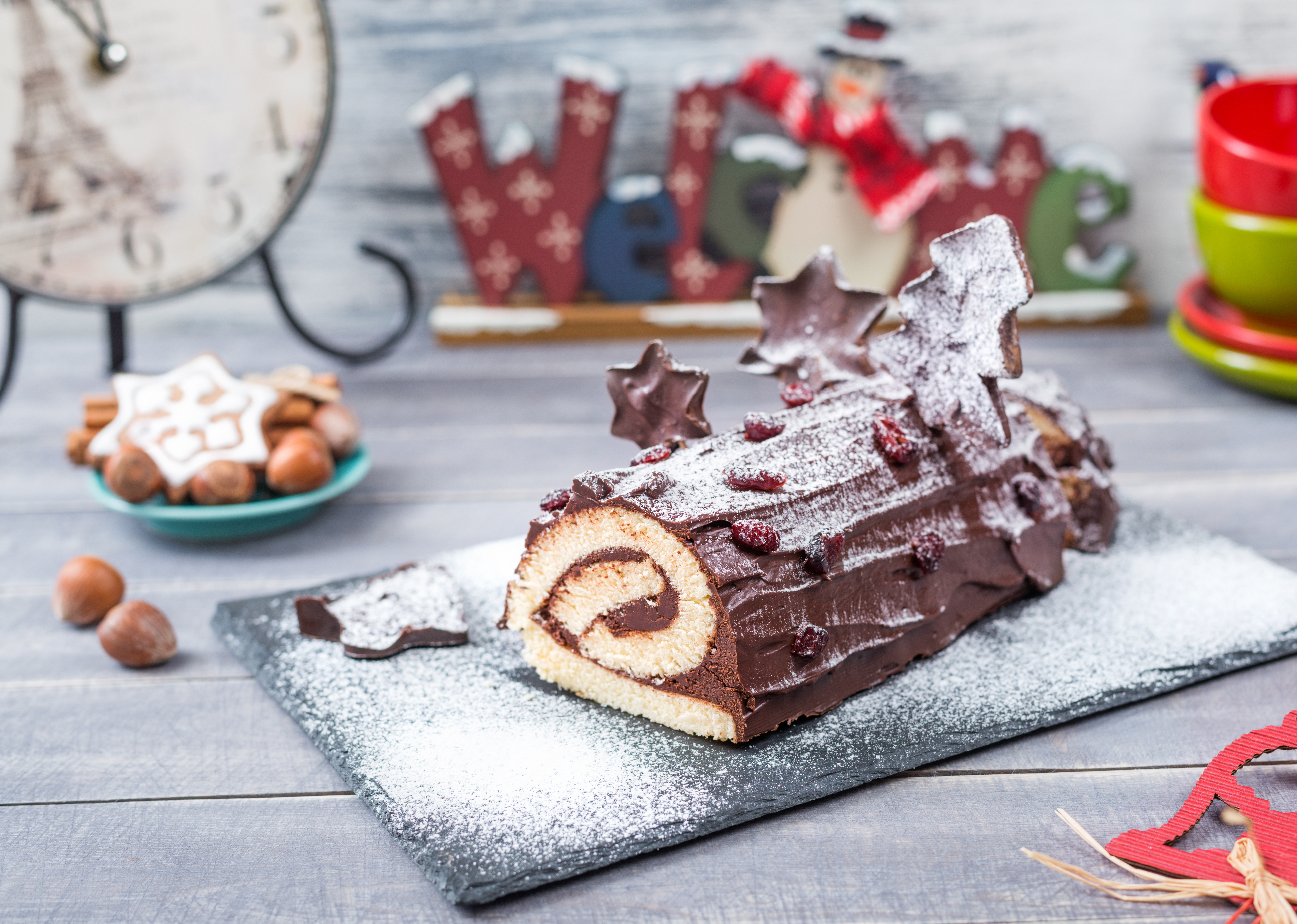 Cakes Bush de Noel Christmas Log home kitchen on New Year decorated wooden background
